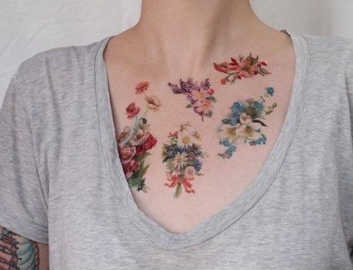 Pretty Simple Flower Tattoo On Chest Tattoomagz