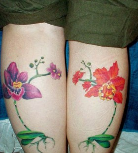 Red and purple flower tattoo on leg