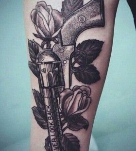 Red roses and gun tattoo