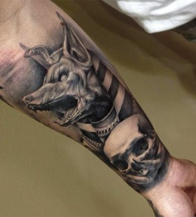 Scary skull and dog tattoo on arm