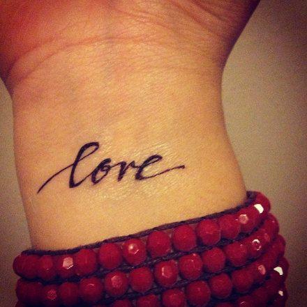 Simple pretty love tattoo on arm
