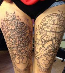 Town ornaments and star tattoo on leg
