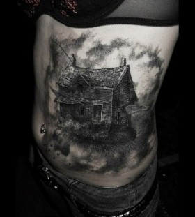 Black wolf's and house tattoo