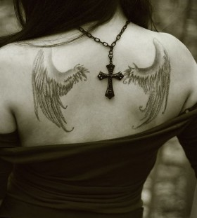 Cross and black angel tattoo on shoulder