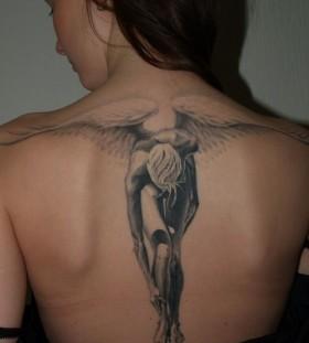 Huge men's angel tattoo on shoulder