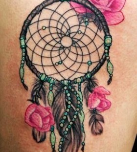 Red roses and dreamcatcher tattoo
