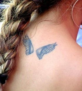 Small lovely angel tattoo on shoulder