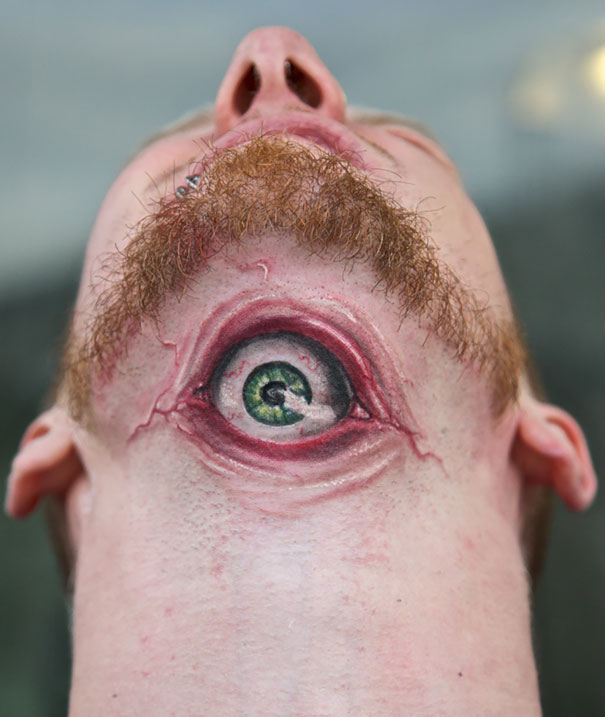 3D creepy eye under chin tattoo