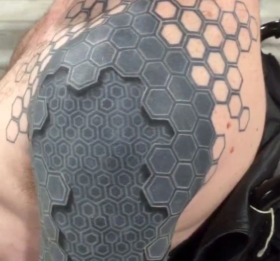 3D man to machine tattoo on arm