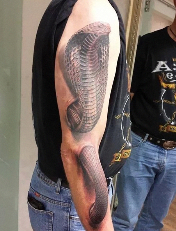 3D snake on arm tattoo