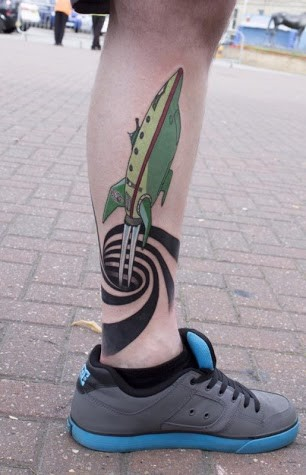 3D space shuttle coming out of black hole on calf tattoo