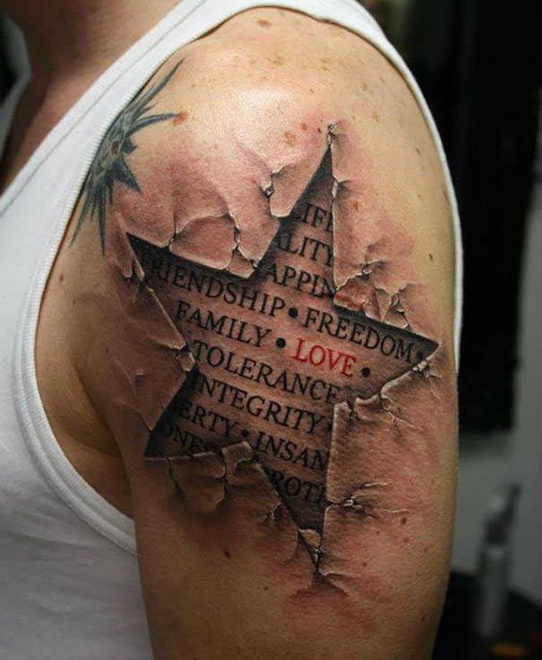 3D star on upper arm tattoo