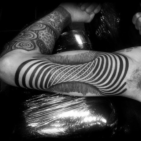 3D tornado like twist on arm tattoo