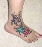 Wonderful Flower Tattoo Designs on Woman's Foot