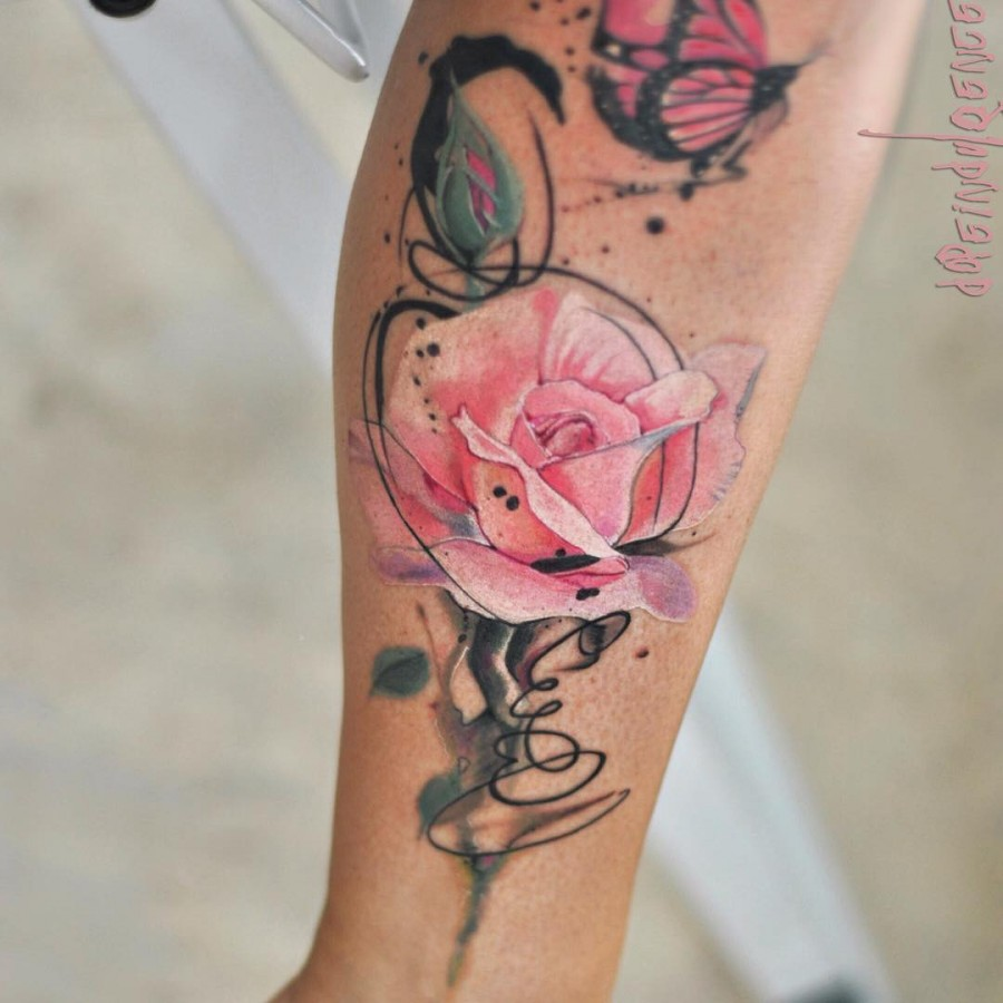 This blooming rose watercolor flower tattoo.