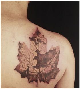 Awesome maple leaf back tattoo
