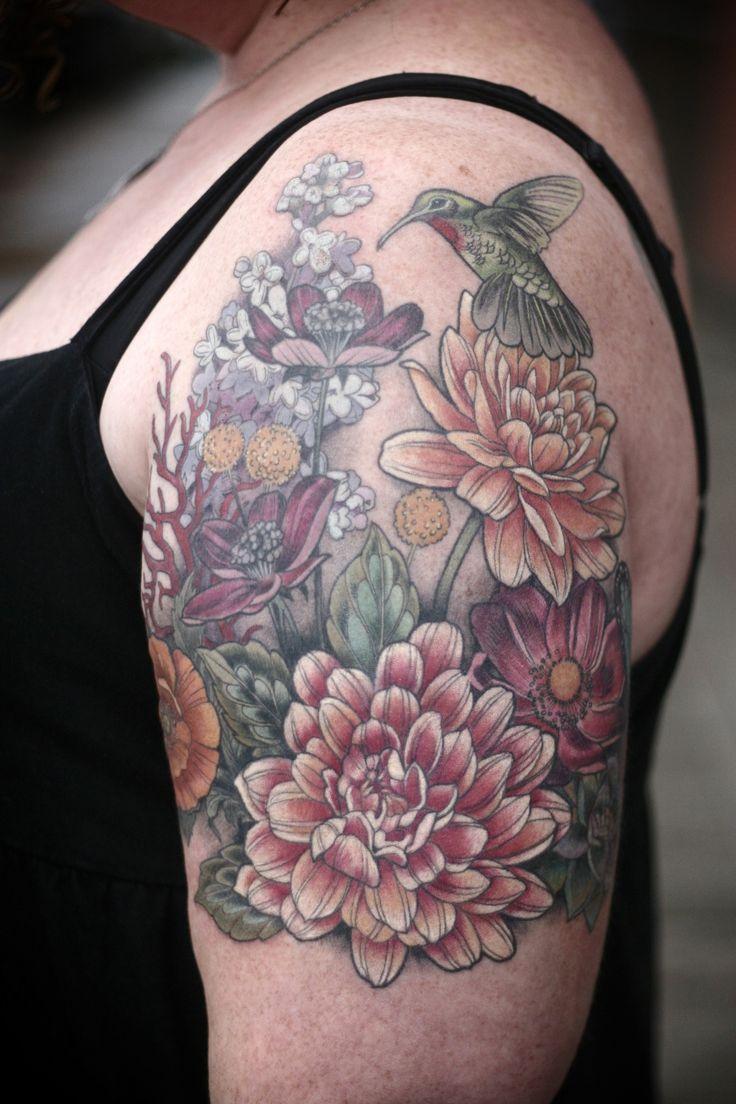 Beautiful flowers and bird tattoo by alice kendall tattoomagz izmirmasajfo