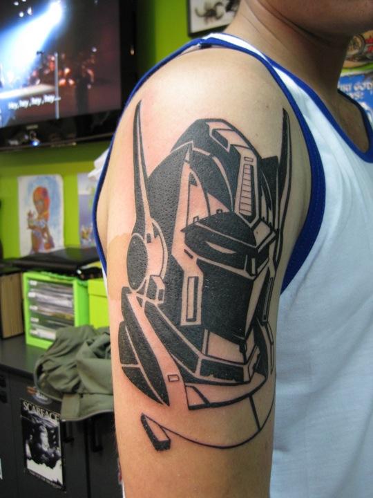 Black ink transformers tattoo - TattooMagz