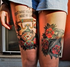 Blue fish and telephone tattoo