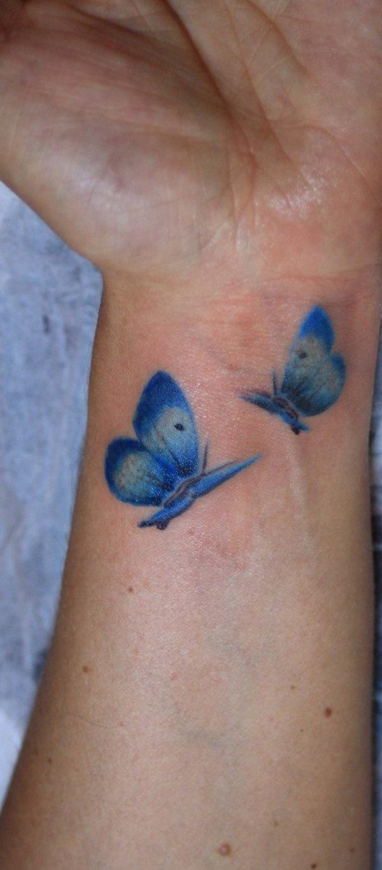 Blue wrist watercolor butterfly tattoo - TattooMagz
