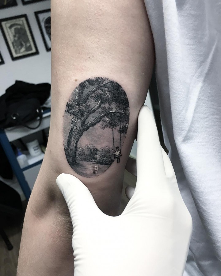 boy-on-tree-swing-circle-tattoo