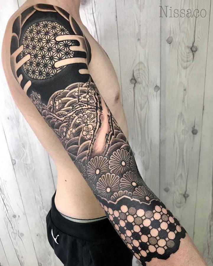 brilliant sleeve tattoo by nissaco