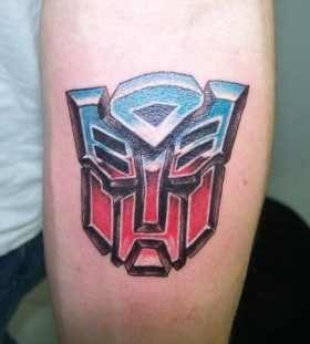Coloured transformers logo tattoo - TattooMagz