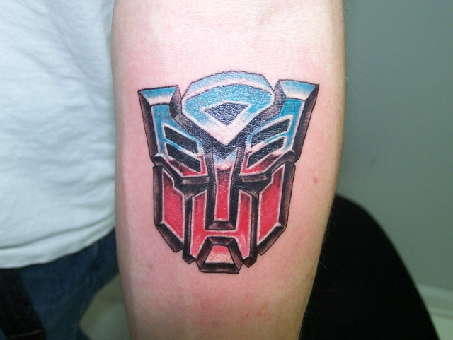 http://tattoomagz.com/wp-content/uploads/Coloured-transformers-logo-tattoo.jpg