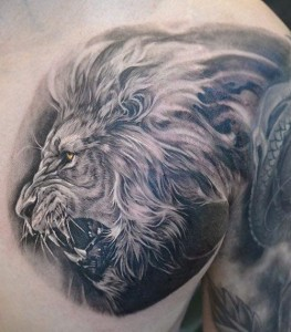 Cool lion tattoo by Elvin Yong