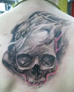 Cool skull tattoo by Elvin Yong