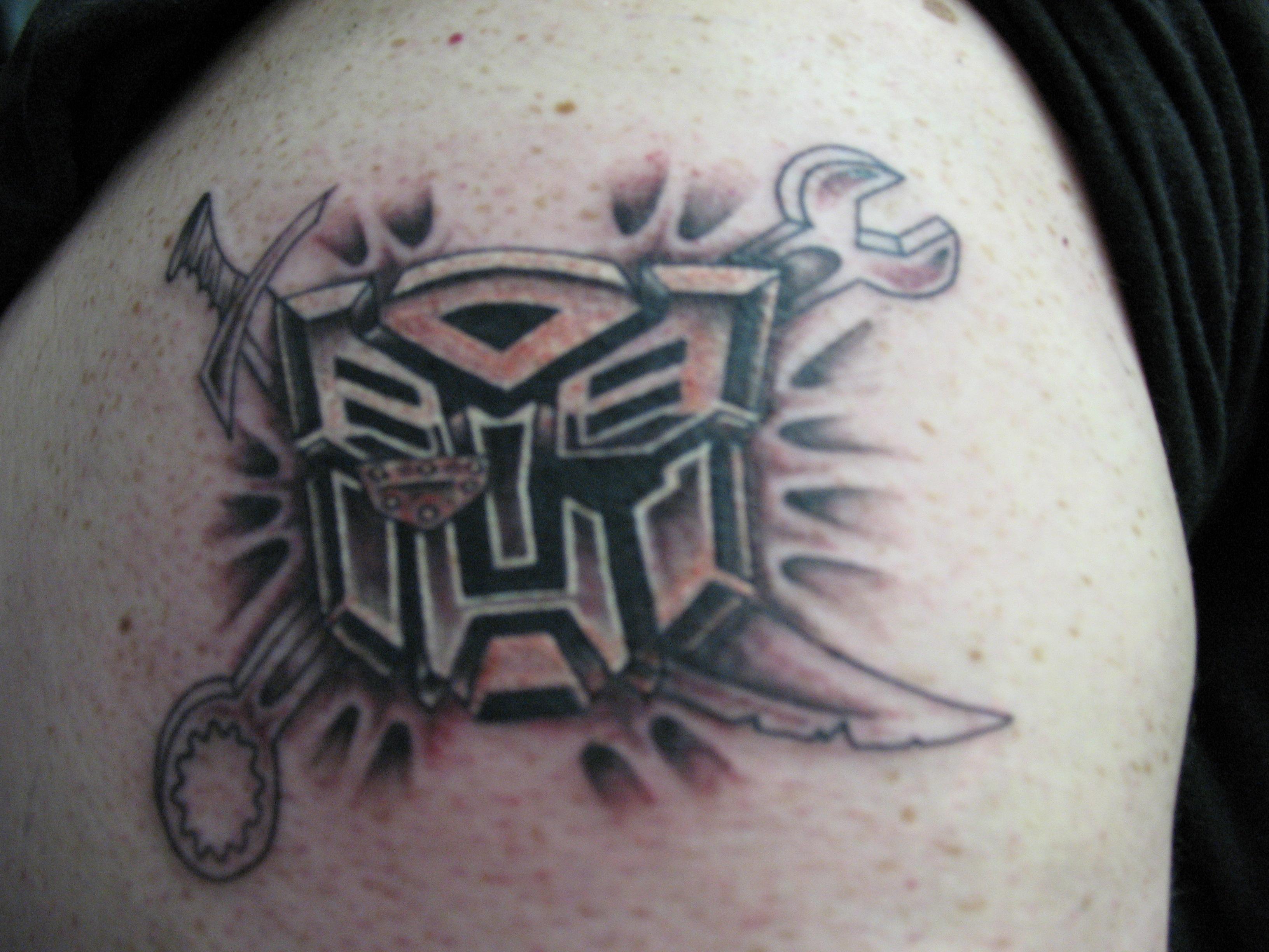 Custom transformers logo tattoo - TattooMagz