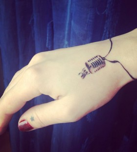 Cute microphone tattoo by Razvan Popescu