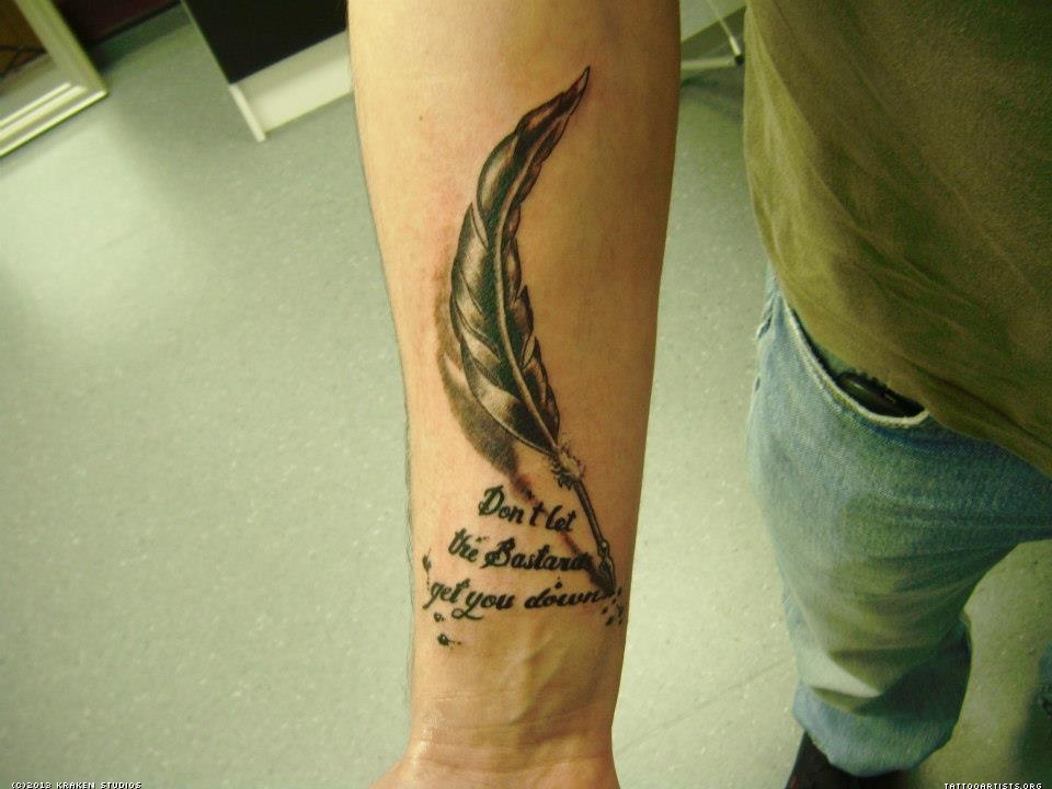 Feather pen and quote arm tattoo - TattooMagz