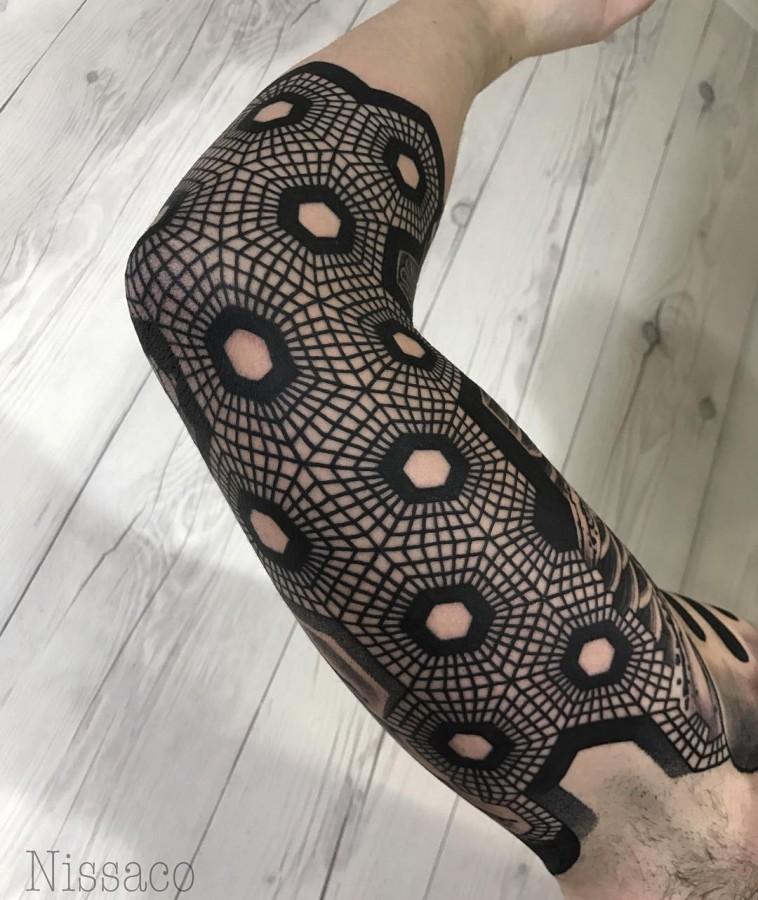 geometric sleeve tattoo by nissaco