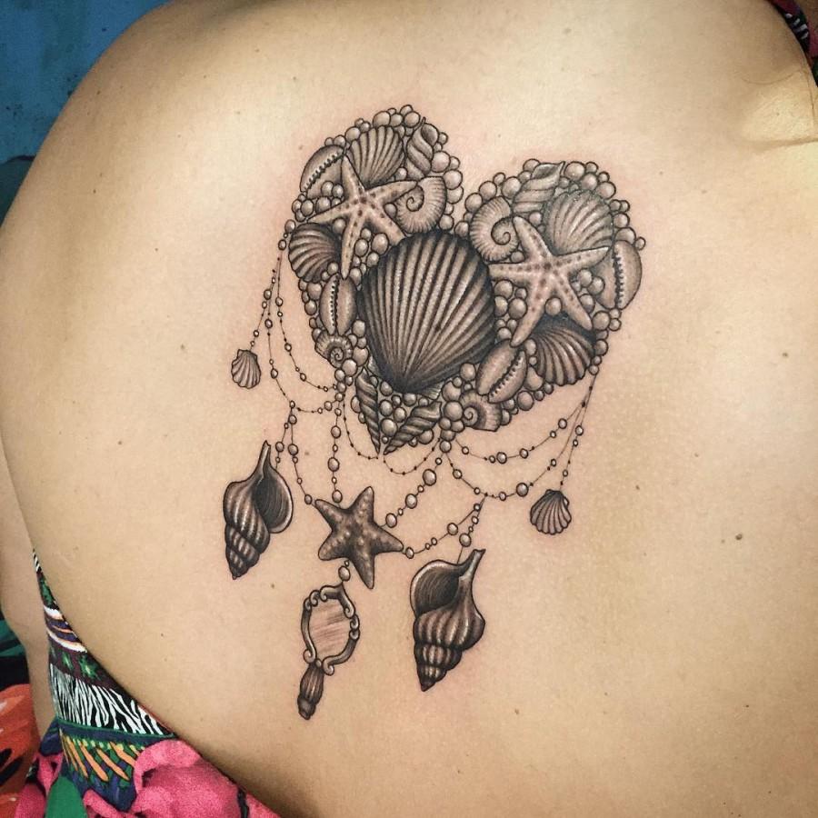 heart shapped shell tattoo by marilia
