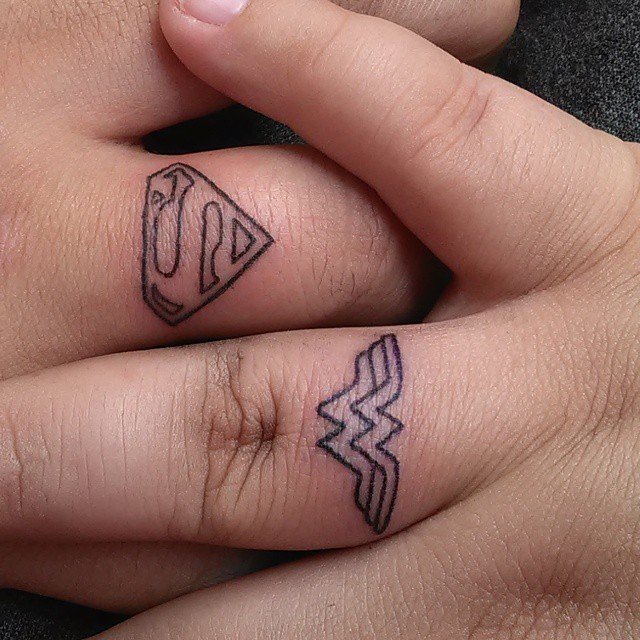 His and hers superchero couples tattoo