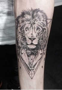 Lion in a suit tattoo by Emrah Özhan