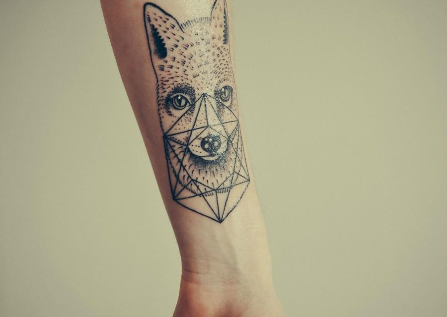 Животные из треугольников тату