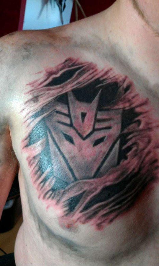 http://tattoomagz.com/wp-content/uploads/Nice-transformers-logo-tattoo-538x900.jpeg