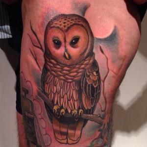 Owl on a branch tattoo by Jon Mesa