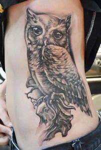 Owl side tattoo by Elvin Yong
