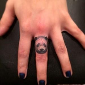 Panda finger tattoo by Jon Mesa