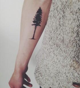 Pine tree tattoo on arm