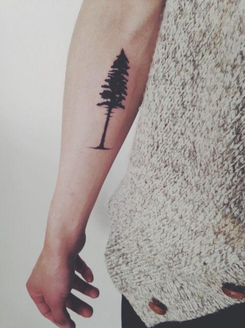 Pine tree tattoo on arm - TattooMagz