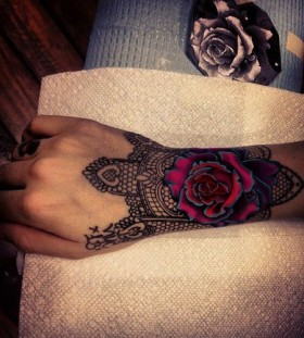 Pink bright flower rose and black lace tattoo