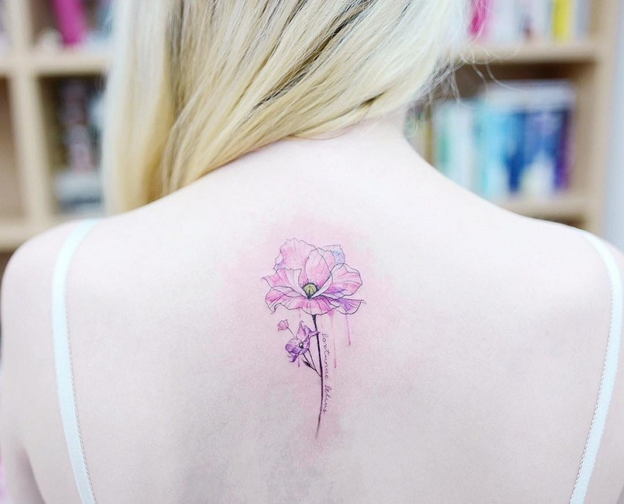 poppy flower tattoo by tattooist banul