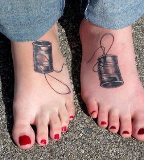 Red nails and telephone tattoo