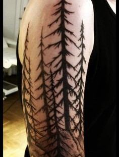 Simple pine trees arm tattoo