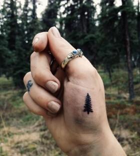 Small pine tree palm tattoo