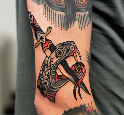 Stabbed Snake With A Dagger Tattoo By Philip Yarnell